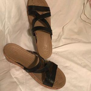 Crocs black sandal.